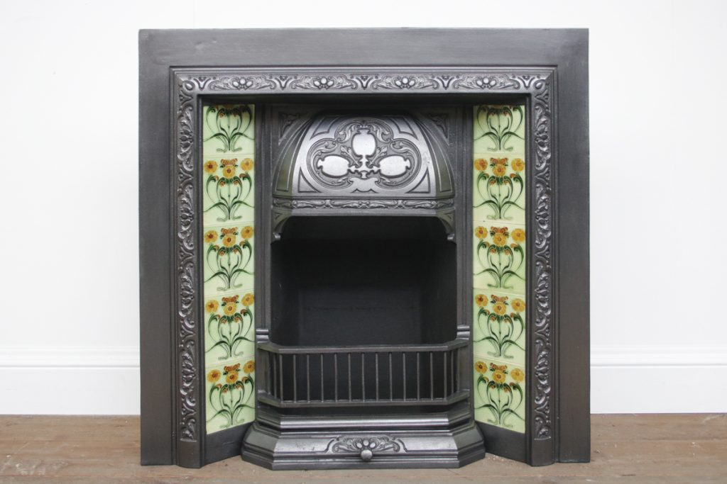 Reclaimed Edwardian Art Nouveau tiled fireplace grate.-0