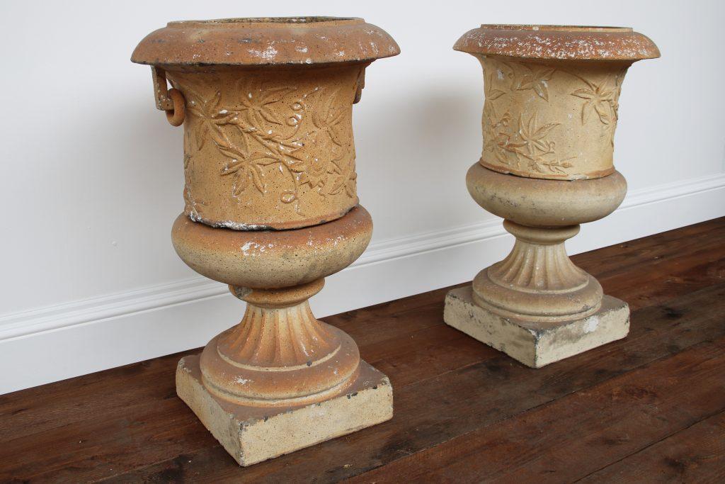 A pair of Victorian clay garden urns on pedestals-0