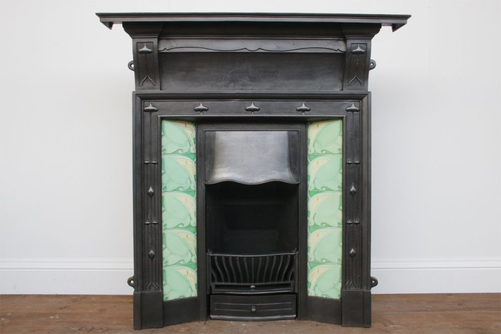 Antique Edwardian cast iron and tiled combination fireplace in the Arts and Crafts manner.-0
