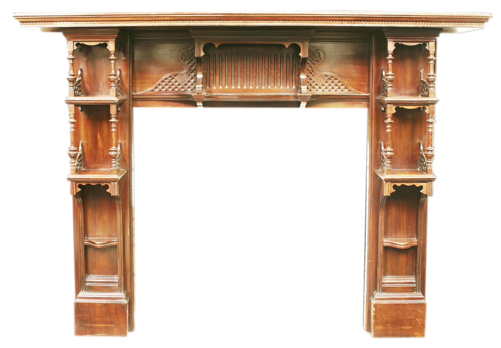 Antique mahogany fireplace in Chippendale style. -0